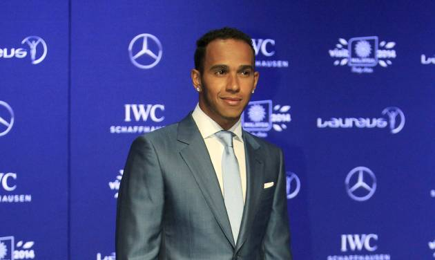 Britain's Formula One driver Lewis Hamilton arrives at the Laureus World Sports Awards in Kuala Lumpur, Malaysia, Wednesday, March 26, 2014. (AP Photo/Lai Seng Sin)