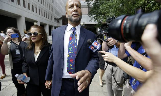 Former New Orleans Mayor Ray Nagin leaves federal court, with his wife, Seletha Nagin, left, after being sentenced in New Orleans, Wednesday, July 9, 2014. Nagin was sentenced to 10 years in prison for bribery, money laundering and other corruption that spanned his two terms as mayor, including the chaotic years after Hurricane Katrina hit in 2005. He was convicted Feb. 12 of accepting hundreds of thousands of dollars from businessmen who wanted work from the city or Nagin's support for various projects. The bribes came in the form of money, free vacations and truckloads of free granite for his family business. (AP Photo/Gerald Herbert)