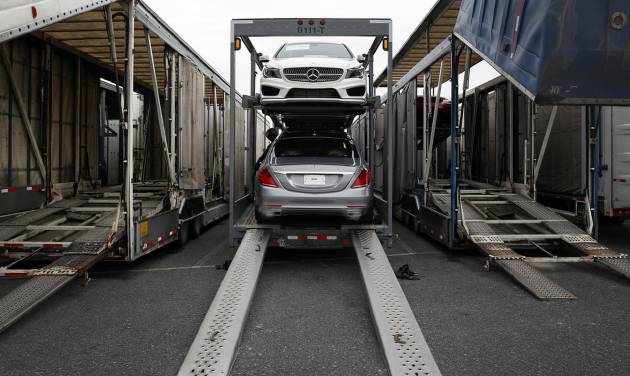 In this March 27, 2014 picture, a Mercedes-Benz sedans sit inside a car-carrier before being hauled away for distribution from the company's Vehicle Processing Center in Baltimore. The Commerce Department reports on the U.S. trade deficit for March on Tuesday, May 6, 2014. In February, the gap climbed to its highest level in five months as demand for American exports fell while imports rose slightly. (AP Photo/Patrick Semansky)