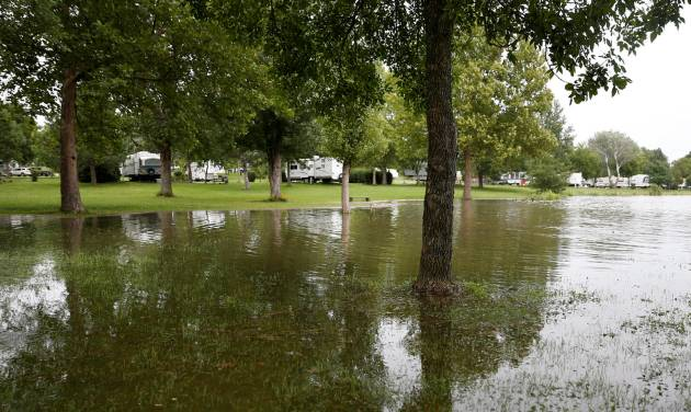 In this photo taken on Thursday, Aug. 28 2014, heavy overnight rain flooded areas of Branched Oak Lake in Raymond, Neb. (AP Photo/The Journal-Star, Raymond Little) LOCAL TELEVISION OUT; KOLN-TV OUT; KGIN-TV OUT; KLKN-TV OUT