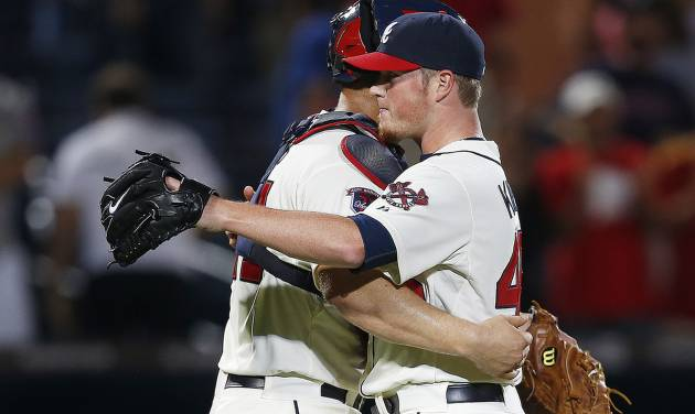 Atlanta Braves closer Craig Kimbrel, right, and catcher Evan Gattis, left, celebrate their 2-0 victory over Chicago Cubs in a baseball game Saturday, May 10, 2014, in Atlanta.  (AP Photo/John Bazemore)