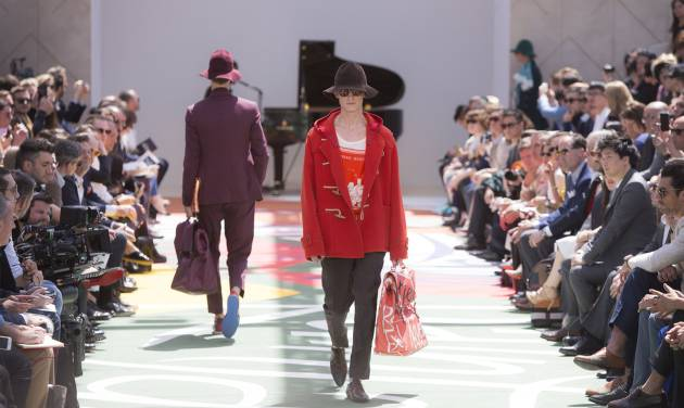 A model wears a creation by Burberry Prorsum during London Collections for Men Spring/Summer 2015 at Kensington Gardens, central London, Tuesday, June 17, 2014. (Photo by Joel Ryan/Invision/AP)
