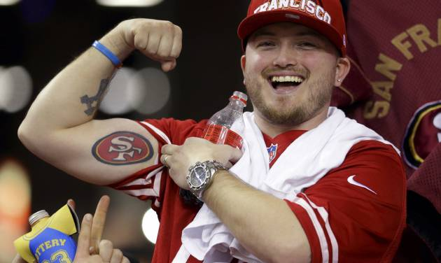 A San Francisco 49ers fan shows off his tattoo  after the NFL football NFC Championship game against the Atlanta Falcons Sunday, Jan. 20, 2013, in Atlanta. The 49ers won 28-24 to advance to Super Bowl XLVII. (AP Photo/Mark Humphrey)