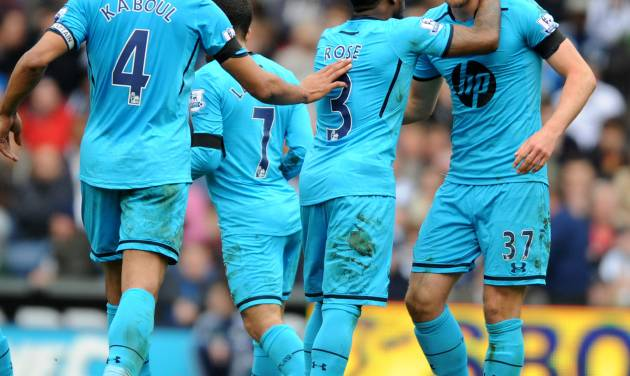 Tottenham Hotspur's Harry Kane, right, is congratulated by his teammates after scoring against West Bromich Albion during the English Premier League soccer match at The Hawthorns Stadium in West Bromwich, England, Saturday, April 12, 2014. (AP Photo/Rui Vieira)