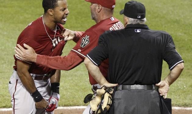 Arizona Diamondbacks' Chris Young, left, is restrained by manager Kirk Gibson as he argues with home plate umpire Larry Vanover, right, after being ejected for arguing a called third strike for the last out in the of the top of the seventh inning of the baseball game against the Pittsburgh Pirates on Wednesday, Aug. 8, 2012, in Pittsburgh. The Pirates won 7-6. (AP Photo/Keith Srakocic)