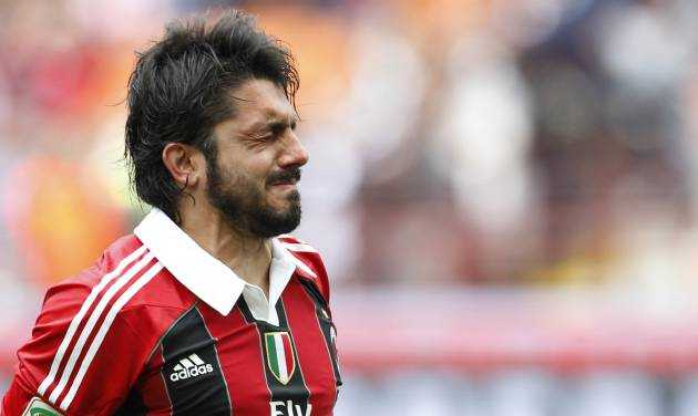 FILE - In this Sunday, May 13, 2012, AC Milan midfielder Gennaro Gattuso cries at the end of a Serie A soccer match between AC Milan and Novara, at the San Siro stadium in Milan, Italy. Former AC Milan and Italy standout Gennaro Gattuso has been placed under investigation for match-fixing and four more people have been arrested in an early morning police sweep in Italy. Cremona prosecutor Roberto Di Martino, who has been leading the Last Bet operation for three years, confirmed to The Associated Press Tuesday, Dec. 17, 2013 that Gattuso and retired Lazio player Cristian Brocchi allegedly were part of a ring that fixed Serie A and other Italian matches at the end of the 2010-11 season. The four people arrested are Salvatore Spadaro, Francesco Bazzani, Cosimo Rinci and Fabio Quadri, each of whom allegedly helped connect fixers to players. More than 50 people have been arrested in Italy for match-fixing since mid-2011, with matches under investigation by prosecutors in Cremona, Bari and Naples. (AP Photo/Luca Bruno, File)