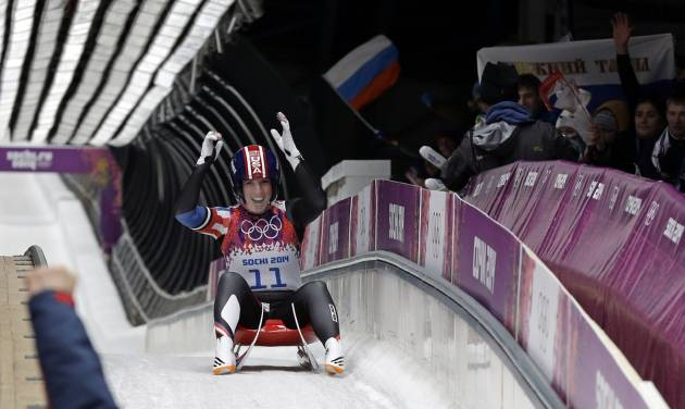 Erin Hamlin of the United States greets her coach after finishing her final run to win the bronze medalduring the women's singles luge competition at the 2014 Winter Olympics, Tuesday, Feb. 11, 2014, in Krasnaya Polyana, Russia. (AP Photo/David J. Phillip )