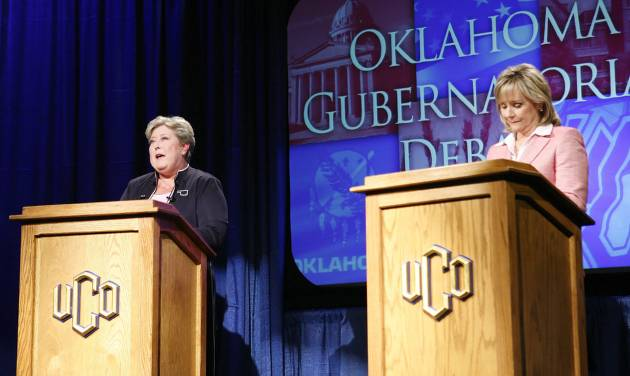 Oklahoma Democratic Lt. Gov. Jari Askins, left, answers a question from a panel member while U.S. Rep. Mary Fallin, R-Okla., listens during a gubernatorial debate on the campus of the University of Central Oklahoma in Edmond, Okla., on Tuesday, Oct. 19, 2010. (AP Photo/Alonzo Adams)