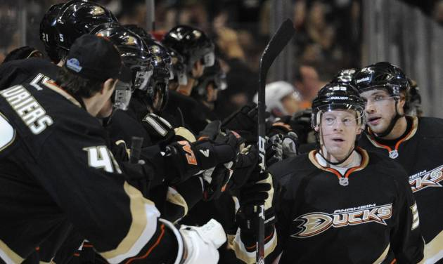 Anaheim Ducks left wing Jason Blake (33) is congratulated by teammates after scoring a goal against the Anaheim Ducks in the period of an NHL hockey game in Anaheim, Calif., Monday, March 5, 2012. (AP Photo/Lori Shepler)
