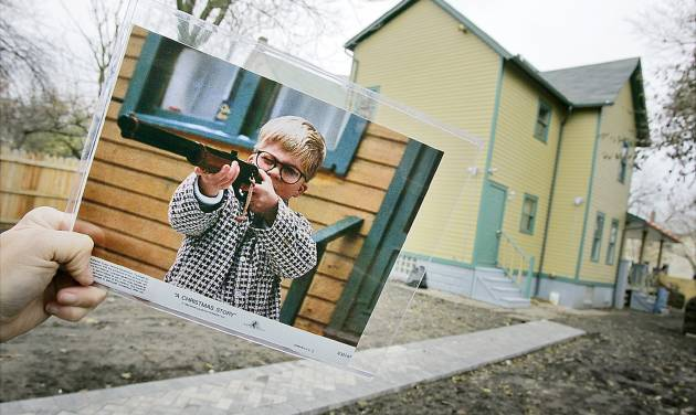 """A photo from """"A Christmas Story"""" shows Ralphie (actor Peter Billingsley) firing his BB gun in the backyard of the house used in the film.AP PHOTO"""