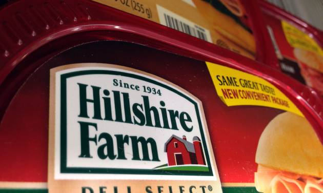 Packages of Hillshire Farm deli meat are displayed at a supermarket in Middleton, Mass., Monday, June 9, 2014. Tyson Foods Inc. has won a bidding war for Hillshire Brands, the maker of Jimmy Dean sausages and Ball Park hot dogs, with a $63 per share offer. (AP Photo/Elise Amendola)