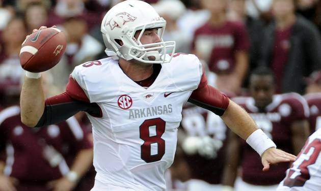 Arkansas quarterback Tyler Wilson prepares to pass during the first half of an NCAA college football game against the Texas A&M Saturday, Sept. 29, 2012, in College Station, Texas. (AP Photo/Pat Sullivan)