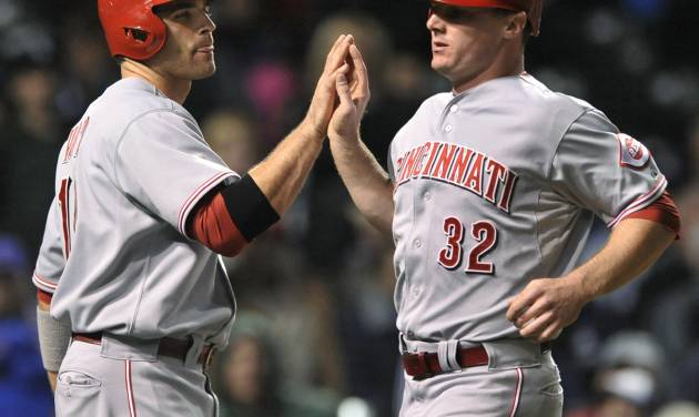 Cincinnati Reds' Joey Votto left, celebrates with Jay Bruce after both scored on a three-run double by Ryan Hanigan in the sixth inning during a baseball game against the Chicago Cubs in Chicago, Tuesday, Sept. 18, 2012. (AP Photo/Paul Beaty)