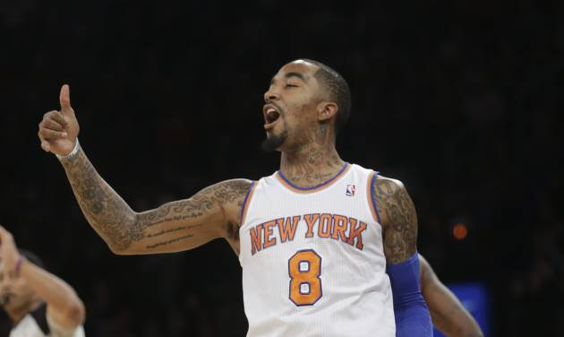 New York Knicks' J.R. Smith (8) reacts after scoring during the first half of an NBA Basketball game game against the Detroit Pistons Tuesday, Jan. 7, 2014, in New York.  (AP Photo/Frank Franklin II)