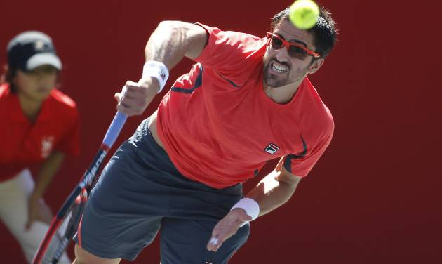Janko Tipsarevic of Serbia serves to Marco Chiudinelli of Switzerland during their second round match of the Japan Open tennis championships in Tokyo Thursday, Oct. 4, 2012. Tipsarevic won the match, 6-4, 6-2. (AP Photo/Shuji Kajiyama)