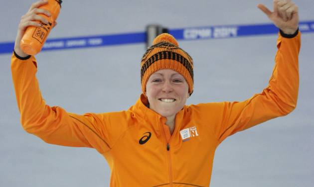 Gold medallist Jorien ter Mors of the Netherlands celebrates after the women's 1,500-meter speedskating race at the Adler Arena Skating Center during the 2014 Winter Olympics in Sochi, Russia, Sunday, Feb. 16, 2014. (AP Photo/David J. Phillip )