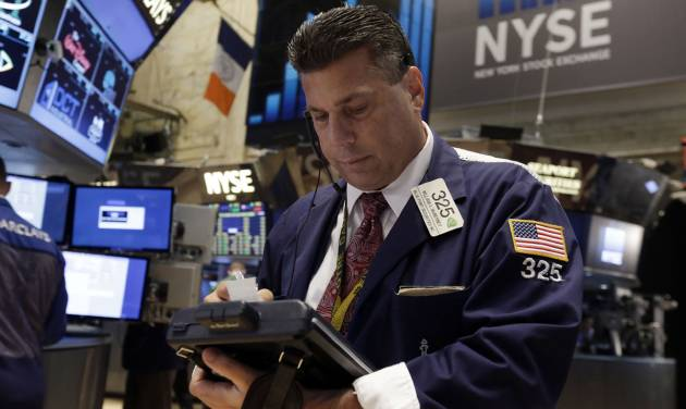 Trader William McInerney works on the floor of the New York Stock Exchange Tuesday, July 1, 2014. The stock market rose in early trading after a report showed that manufacturing in the US and China expanded in June, boosting the outlook for global growth. (AP Photo/Richard Drew)