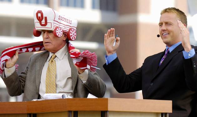 Stillwater, Okla. - October 30, 2004. University of Oklahoma (OU) at Oklahoma State University (OSU) Bedlam college football in Boone Pickens Stadium.  Lee Corso, left, puts on an OU hat and scarf as Kirk Herbstreit spells OU with his arms. The College GameDay analysts picked Oklahoma to beat Oklahoma State. By Nate Billings/The Oklahoman
