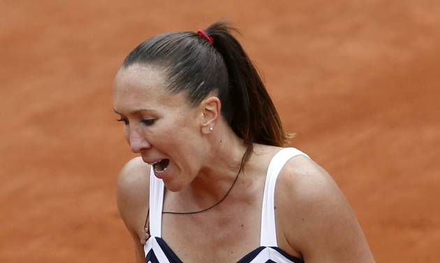 Serbia's Jelena Jankovic clenches her fist as she plays Japan's Kurumi Nara during the second round match of  the French Open tennis tournament at the Roland Garros stadium, in Paris, France, Thursday, May 29, 2014. Jankovic won 7-5, 6-0. (AP Photo/Darko Vojinovic)
