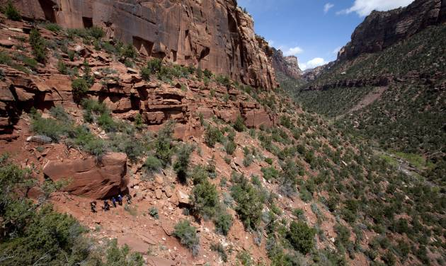 In this April 26, 2011 file photo, search and rescue team members escort overdue hikers up and out of the canyon carved by the Left Fork of North Creek, more commonly known as the Subway in Zion National Park. A 74-year-old man was found dead after spending a night hanging upside down on his climbing ropes at Zion National Park, the park superintendent said Thursday, Sept. 20, 2012. It was the first death of a hiker in the Subway in many years _park officials were unable to immediately determine when the last death occurred there, although they are frequently called to rescue distressed hikers. (AP Photo/The Spectrum & Daily News, Jud Burkett)