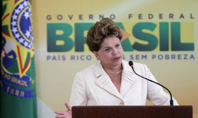 """Brazil's President Dilma Rousseff speaks during a ceremony where she announced an economic stimulus package at Planalto presidential palace in Brasilia, Brazil, Wednesday, June 27, 2012. The program announced by Rousseff focuses on a wide array of government purchases, from backhoes to motorcycles to military equipment. Rousseff says the government will use stimulus packages """"without restriction"""" as Brazil is hit by the crisis in Europe and hobbled by slowing domestic consumer demand. (AP Photo/Eraldo Peres)"""
