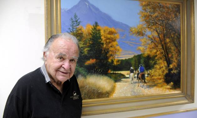 This June 2012 photo shows former 'Mad' magazine editor Al Feldstein standing near one of his paintings at Livingston HealthCare. Feldstein, whose 28 years at the helm of Mad magazine transformed the satirical publication into a pop culture institution, has died, Tuesday, April 29, 2014. He was 88. (AP Photo/Livingston Enterprise, Aaric Bryan)
