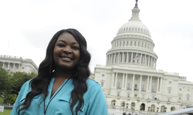 "FILE - This July 3, 2013 file photo shows American Idol 2013 winner Candice Glover on Capitol Hill in Washington. Glover from ""American Idol"" will help reopen the Washington Monument, which has been closed since a 2011 earthquake. Organizers say Glover will join with the Old Guard Fife and Drum Corps, the U.S. Navy Band and the boy and girl choristers of the Washington National Cathedral Choir for the May 12 re-opening ceremony. The ""Today"" show's Al Roker will host the event. (AP Photo/Susan Walsh, File)"