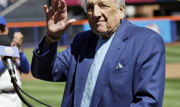 FILE - In this April 5, 2012 file photo, Hall of Famer Ralph Kiner waves to the crowd before announcing the New York Mets starting line-up before an opening day baseball game against the Atlanta Braves at Citi Field in New York. The baseball Hall of Fame says slugger Ralph Kiner has died. He was 91. The Hall says Kiner died Thursday, Feb. 6, 2014, at his home in Rancho Mirage, Calif.WLD (AP Photo/Frank Franklin II, File)