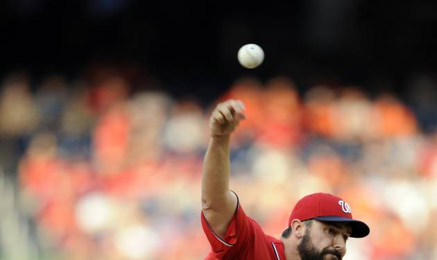 Washington Nationals starting pitcher Tanner Roark (57) delivers a pitch against the Baltimore Orioles during the first inning of a baseball game, Monday, Aug. 4, 2014, in Washington. (AP Photo/Nick Wass)