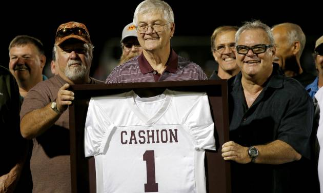 Former Cashion coach Larry Mantle is presented with a jersey by his former players as he is honored during halftime of Cashion's high school football game against Minco in Cashion, Okla., Friday, Sept. 27, 2013. Photo by Bryan Terry, The Oklahoman