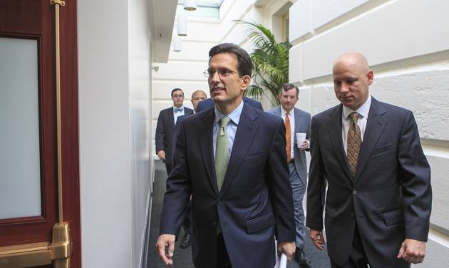 In this Sept. 10, 2013, photo, House Majority Leader Eric Cantor, R-Va., walks to a Republican strategy session at the Capitol, in Washington. A revolt by tea party conservatives forced House GOP leaders on Wednesday, Sept. 11, to delay a vote on a temporary spending bill required to prevent a government shutdown next month. The plan by top Republicans like Cantor is designed to keep government agencies running through Dec. 15. Cantor's office announced the delay. (AP Photo/J. Scott Applewhite)