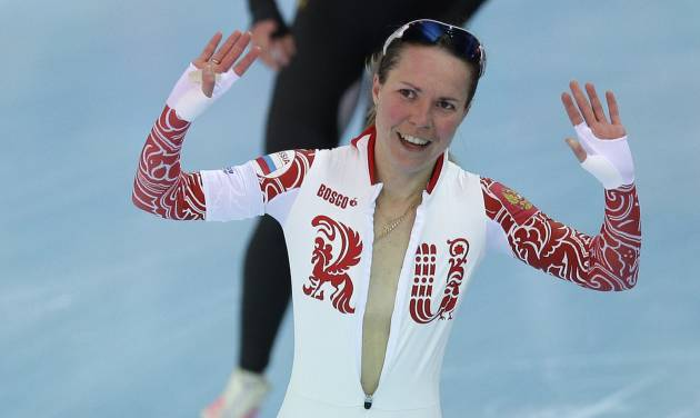 Bronze medallist Olga Graf of Russia celebrates with a wide open front of her skin suit after the women's 3,000-meter speedskating race at the Adler Arena Skating Center during the 2014 Winter Olympics, Sunday, Feb. 9, 2014, in Sochi, Russia. (AP Photo/Pavel Golovkin)