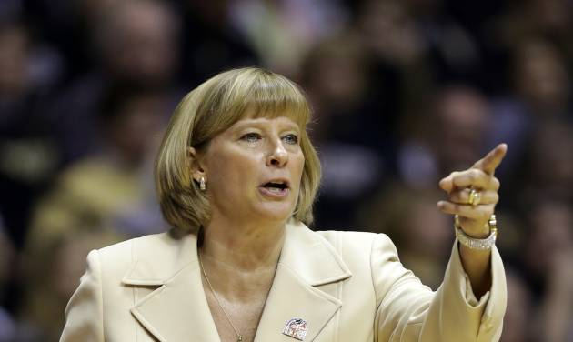 Purdue head coach Sharon Versyp calls a play for her team as they played Akron during the first half of a first-round game in the NCAA women's college basketball tournament, Saturday, March 22, 2014, in West Lafayette, Ind. (AP Photo/Michael Conroy)
