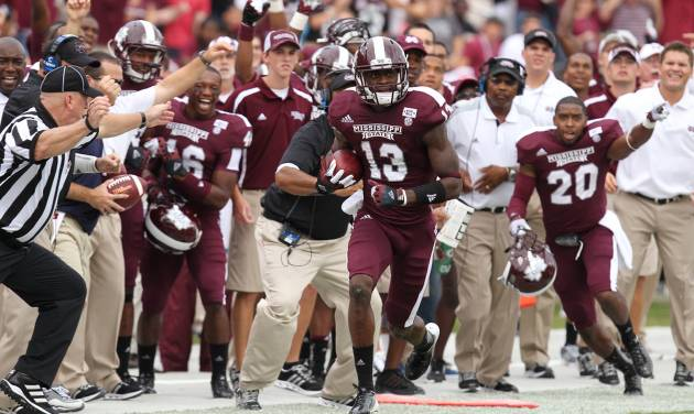 Mississippi State defensive back Johnthan Banks (13) runs after intercepting a pass in the first half of an NCAA college football game against Auburn Saturday, Sept. 8, 2012 in Starkville, Miss. (AP Photo/The Clarion-Ledger, Keith Warren) NO SALES