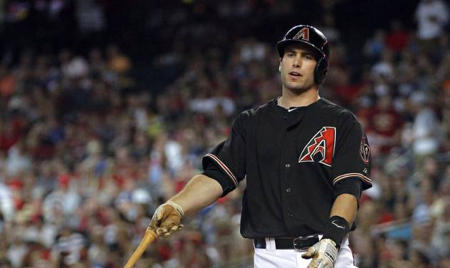 Arizona Diamondbacks' Paul Goldschmidt tosses hit bat after striking out against the Washington Nationals during the first inning of a baseball game, Saturday, Aug. 11, 2012, in Phoenix. (AP Photo/Matt York)