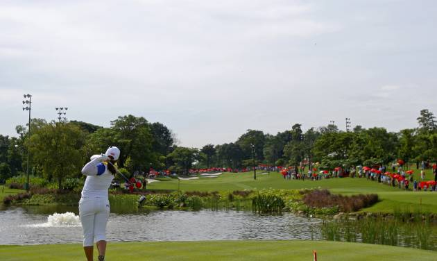 Inbee Park of South Korea tees off on the 3rd hole during the final round of the LPGA Malaysia golf tournament at Kuala Lumpur Golf and Country Club in Kuala Lumpur, Malaysia, Sunday, Oct. 14, 2012. (AP Photo/Lai Seng Sin)