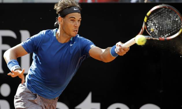 Spain's Rafael Nadal returns the ball to Russia's Mikhail Youzhny during their match at the Italian Open tennis tournament, in Rome, Thursday, May 15, 2012. (AP Photo/Andrew Medichini)