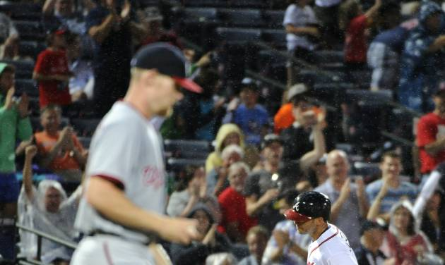 Atlanta Braves' Tommy La Stella, right, rounds third base behind Washington Nationals pitcher Stephen Strasburg after a solo home run during the fifth inning of a baseball game Friday, Aug. 8, 2014, in Atlanta. (AP Photo/David Tulis)
