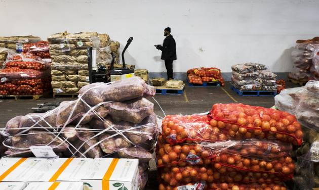 In this Thursday, Jan. 23, 2014, photo, vegetables are stacked in a  warehouse owned by Procacci Brothers, one of the nation's largest produce distributors, in Philadelphia. The Labor Department releases the Producer Price Index for January, on Wednesday, Feb. 19, 2014. (AP Photo/Matt Rourke)