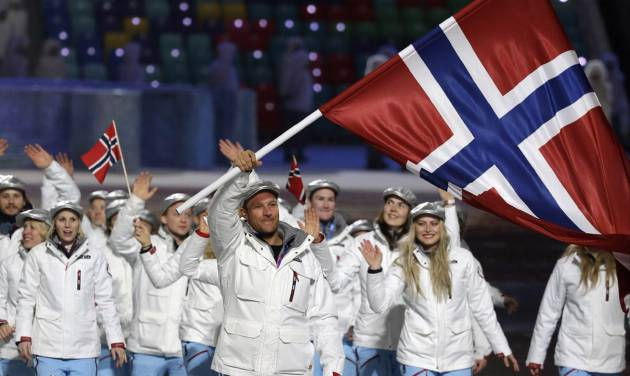 Aksel Lund Svindal of Norway carries the national flag as he leads the team during the opening ceremony of the 2014 Winter Olympics in Sochi, Russia, Friday, Feb. 7, 2014. (AP Photo/Mark Humphrey)