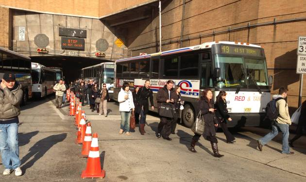 Morning commuters exit the Lincoln Tunnel in New York, Monday, Nov. 12, 2012, after the tunnel was closed after two buses collided near the tunnel in New Jersey, injuring about 20 people. (AP Photo/Audrius Juskelis)
