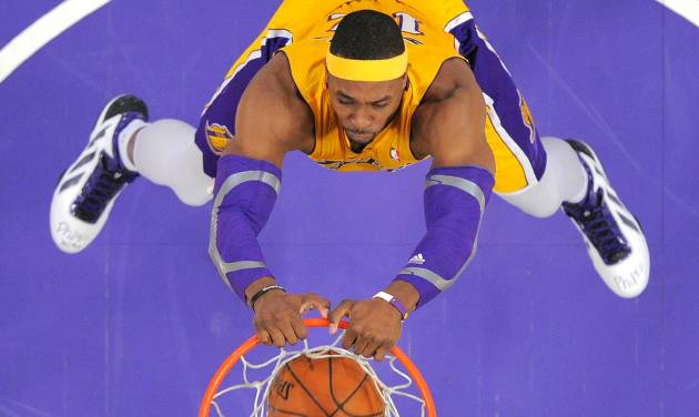 Los Angeles Lakers center Dwight Howard dunks during the first half of their NBA basketball game against the Milwaukee Bucks, Tuesday, Jan. 15, 2013, in Los Angeles. (AP Photo/Mark J. Terrill)