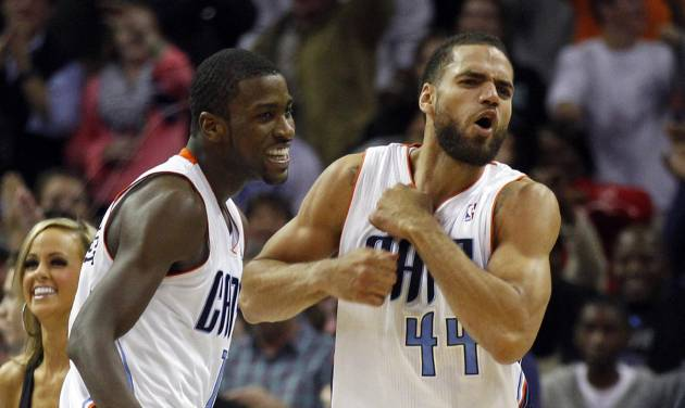 Charlotte Bobcats' Jeffery Taylor, right, and Michael Kidd-Gilchrist, left, react after defeating the Toronto Raptors in an NBA basketball game in Charlotte, N.C., Wednesday, Nov. 21, 2012. The Bobcats won 98-97. (AP Photo/Chuck Burton)