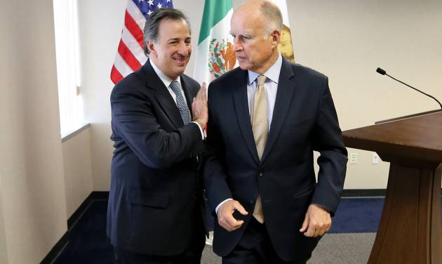 Gov. Jerry Brown, right, and Mexican Secretary of Foreign Affairs Jose Antonio Meade Kuribrena  leave a news conference after talking with reporters Wednesday, July 23, 2014, in Sacramento, Calif.  Brown and Meade attended a luncheon hosted by the California Chamber of Commerce, where they discussed Brown's upcoming visit to Mexico.(AP Photo/Rich Pedroncelli)
