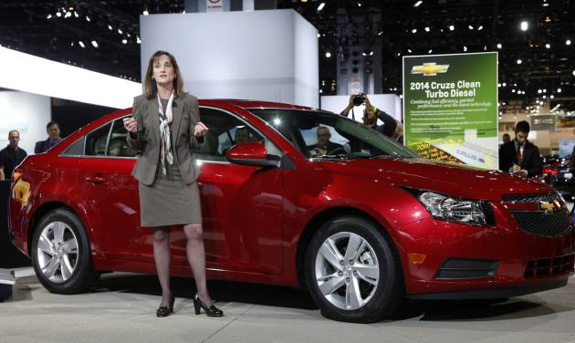 Cristi Landy, Marketing Director Chevrolet Small Cars unveils the 2014 Chevrolet Cruze Diesel at the Chicago Auto Show Thursday, Feb. 7, 2013, in Chicago. (AP Photo/Charles Rex Arbogast)