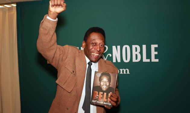 "Brazilian soccer star Pele makes an appearance at Barnes & Noble to signs copies of his book ""Why Soccer Matters"" on Tuesday, April 1, 2014, in New York. (Photo by Luiz Ribeiro/Invision/AP)"