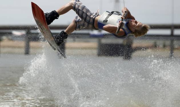 Matt McCaleb, of Edmond, performs a trick during the Oklahoma River Wakeboard Tournament on June 28. PHOTO BY SARAH PHIPPS, THE OKLAHOMAN