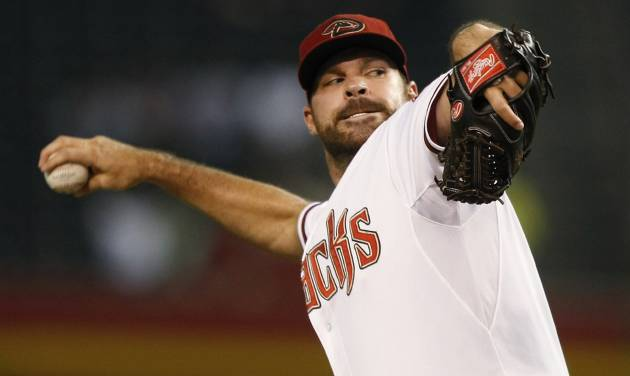 Arizona Diamondbacks starting pitcher Josh Collmenter throws in the first inning during a baseball game against the San Diego Padres, Friday, Aug. 22, 2014, in Phoenix. (AP Photo/Rick Scuteri)