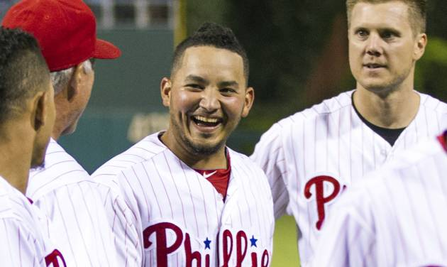 FILE - In a Sept. 7, 2013 file photo, Philadelphia Phillies' Freddy Galvis, center, celebrates with teammates following a baseball game against the Atlanta Braves, in Philadelphia. Phillies reserve infielder Galvis has been diagnosed with an infection caused by MRSA, general manager Ruben Amaro Jr. said Friday, March 21, 2014. MRSA, or Methicillin-resistant Staphylococcus aureus, is a staph bacteria that can cause infections and is resistant to many antibiotics. Galvis was hospitalized Thursday and treated with oral and intravenous antibiotics.  (AP Photo/Chris Szagola, File)