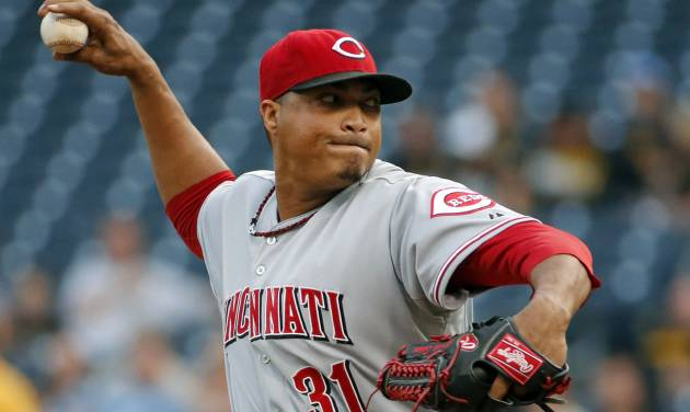 Cincinnati Reds starting pitcher Alfredo Simon (31) delivers during the first inning of a baseball game against the Pittsburgh Pirates in Pittsburgh, Wednesday, June 18, 2014. (AP Photo/Gene J. Puskar)